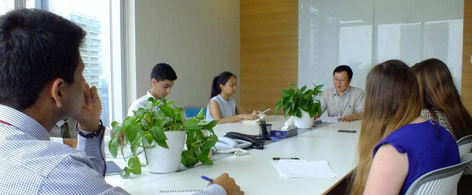 Projects Abroad interns gaining work experience in China attend a meeting held by a local lawyer.